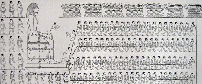 Representación de trabajadores moviendo un coloso.