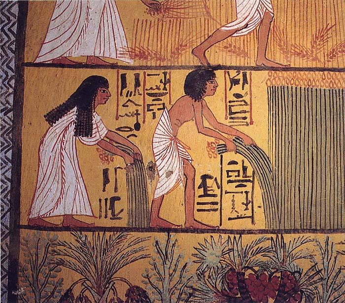 Representación de una pareja durante la cosecha.